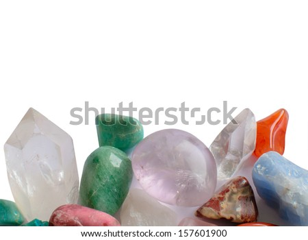 Colorful semiprecious stones, amethyst, quartz crystal, aventurine, turquoise, in green, purple and red colors isolated on white. - stock photo