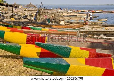 Colorful Senegalese fishing boats. Africa - Senegal - Casamance - Ziguinchor - stock photo