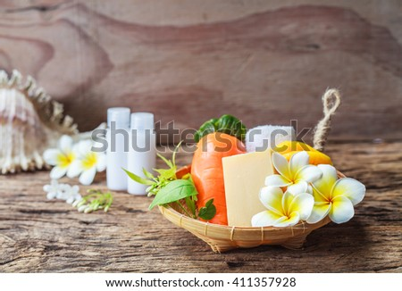 Colorful set of soap spa on wood - stock photo
