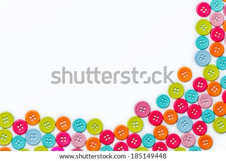 Colorful sewing buttons over a white background  - stock photo