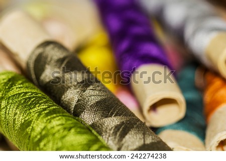 Colorful Sewing Thread Pattern. Colorful miniature bobbins of thread for sewing - stock photo