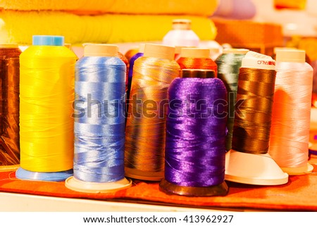 Colorful sewing threads; note shallow depth of field