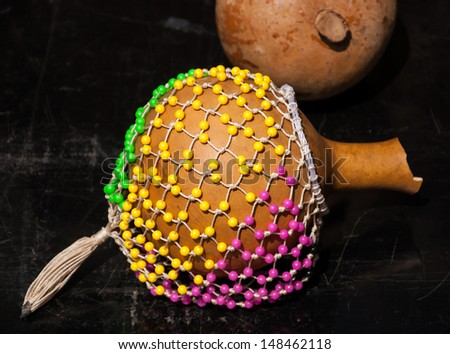 Colorful shekere (gourd rattle). - stock photo