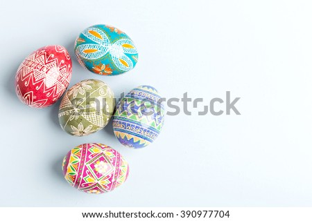 colorful shiny easter eggs on blue background - stock photo