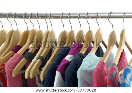 colorful shirt rack in line on white