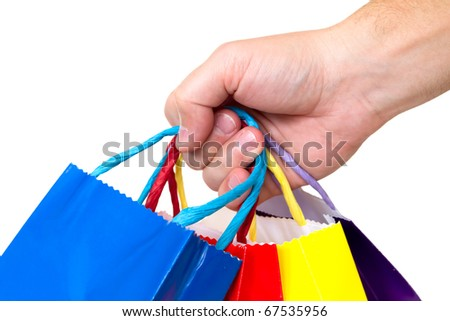 colorful shopping bags and hand