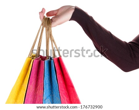 Colorful shopping bags in female hand, isolated on white - stock photo