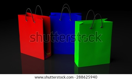 Colorful shopping bags isolated on black background