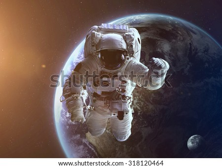 Colorful shot that shows NASA's astronaut in open space near planet Earth. Elements of this image furnished by NASA. - stock photo