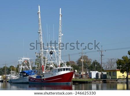 Colorful shrimp trawler boats docked on Bayou Lafourche in Southern Louisiana. - stock photo