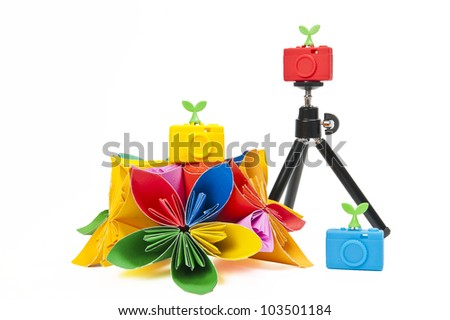 Colorful silicon camera with colorful flower - stock photo