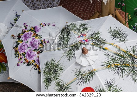 colorful silk umbrellas Handicrafts in Thailand - stock photo