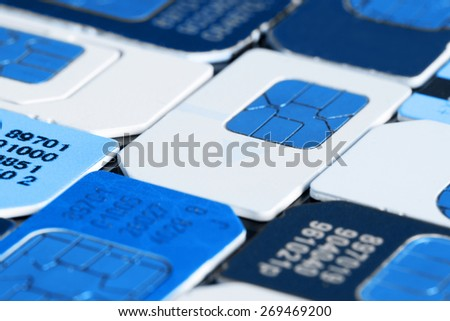 Colorful sim card on a black background, close up - stock photo