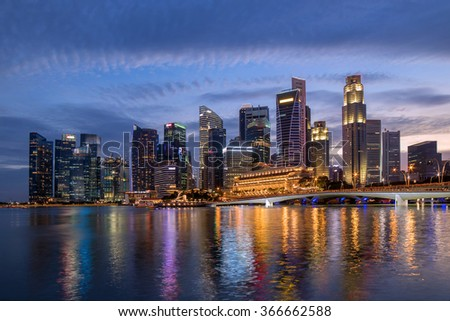 Colorful Singapore business district skyline after sun set at Marina Bay.