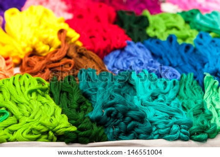 Colorful skeins for sale on the market in Mexico, Latin America. Arts and crafts. - stock photo