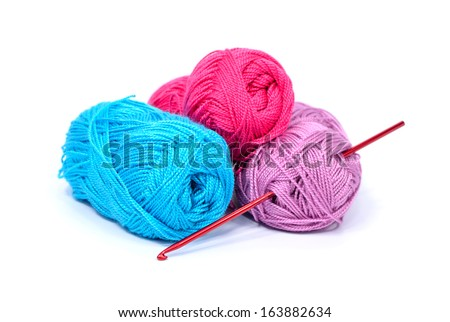 colorful skeins of yarn and crochet hook - stock photo