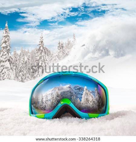 Colorful ski glasses on snow. Winter ski theme. - stock photo
