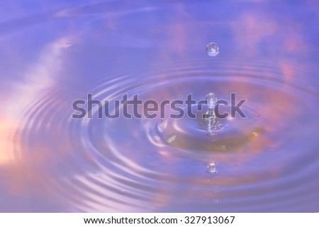 colorful sky of water reflection and water drop for background.