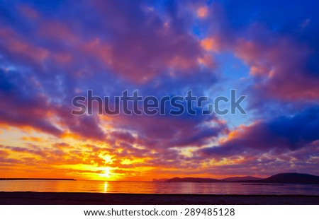 colorful sky over Alghero at sunset, Sardinia - stock photo