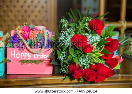 colorful sky, pink and red square bouquet. Happy b-day