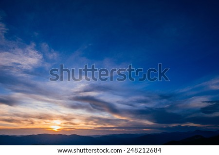 colorful sky with sun background in mountains. sunset, sunrise. - stock photo