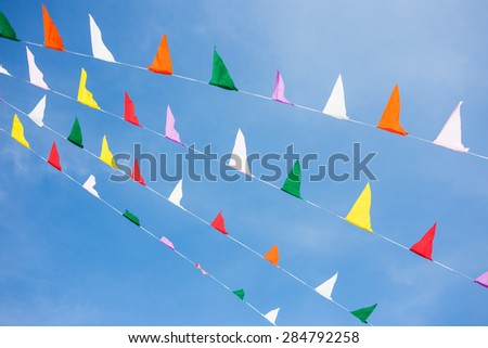 Colorful small flags on a folk festival.