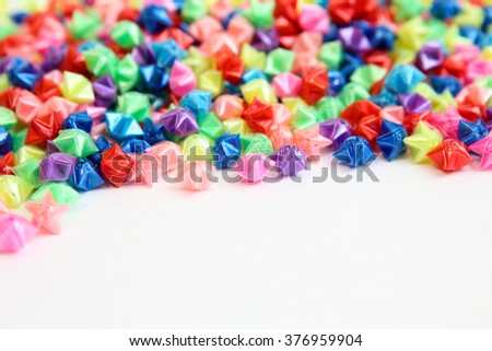 colorful small stars isolated on white background - stock photo