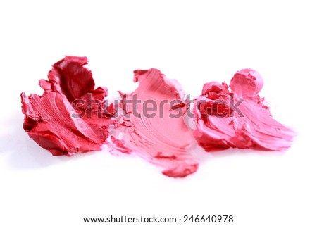 Colorful Smeared Lipstick Colors on White Background - stock photo
