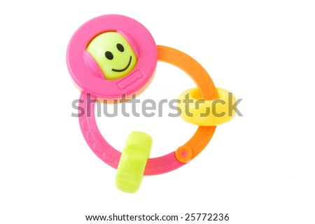 Colorful smiley infant rattle on white background