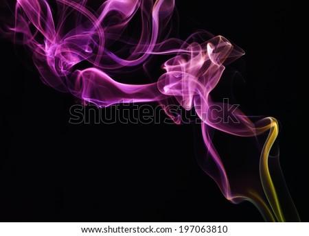 Colorful smoke on black background - stock photo