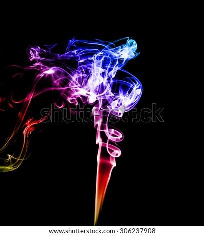 colorful smoke on  black background. - stock photo