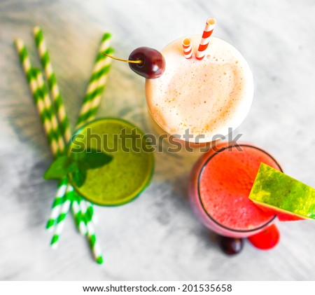Colorful smoothie cocktails - stock photo
