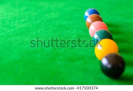 Colorful snooker balls on green table,Focus on pink ball - stock photo
