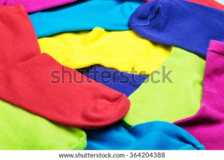 colorful socks background. Focus in center of frame - stock photo
