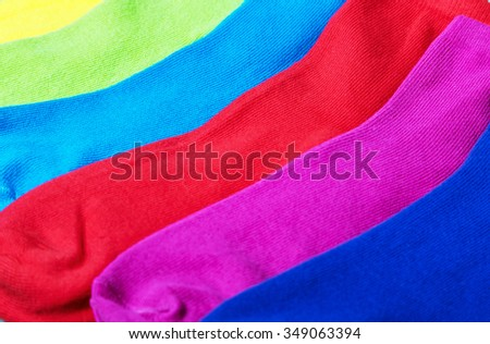 colorful socks background. Focus on blue socks in the top of the frame - stock photo