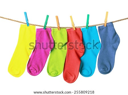 colorful socks hanging on a rope isolated on white background - stock photo
