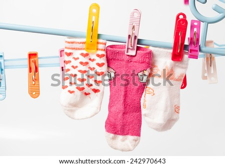 Colorful socks hanging on the clothesline. Image  on white background