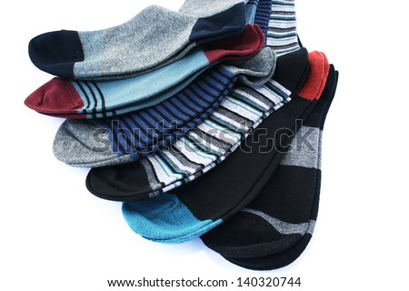 Colorful socks isolated on white background. - stock photo
