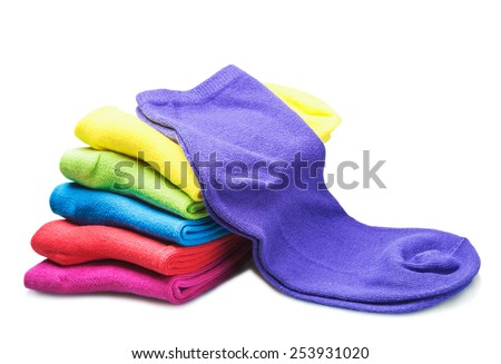 colorful socks isolated on white background. Focus on purple sock  - stock photo