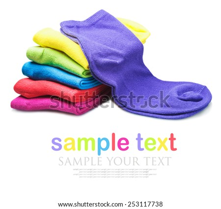 colorful socks isolated on white background. text serves as a model and can be easily removed in the editor. Focus on purple sock  - stock photo
