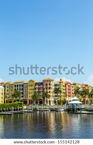 Colorful Spanish influenced buildings overlooking the water in tropical Naples Florida . - stock photo