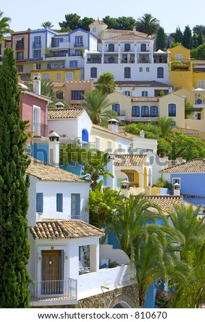 Colorful Spanish pueblo on hillside in Marbella on the Costa del Sol - stock photo