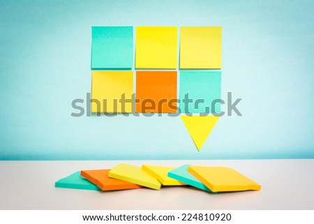 Colorful speech bubble with sticky notes on blue background - stock photo