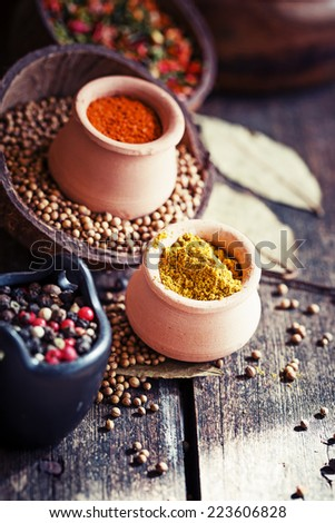 Colorful Spices and herbs over rustic wooden background  - stock photo