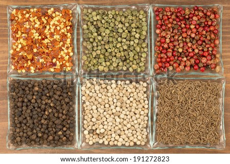 Colorful spices grains on a wooden background