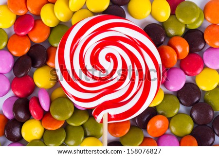 Colorful spiral lollipop candy on stick.