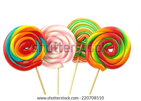 Colorful spiral lollipops on white background - stock photo