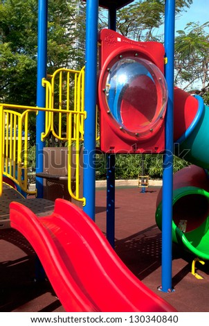 Colorful spiral tube slide at public playground . - stock photo