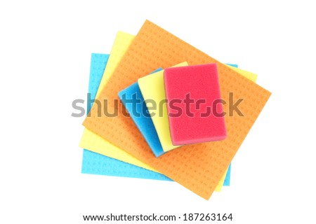 Colorful sponges and cloths for cleaning. Isolated on white.                                - stock photo