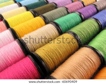 Colorful spools of thread form a beautiful rainbow - stock photo